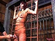 Lesbian in bondage forced to cum