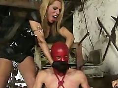 Slave In Red Latex Used By Dommes1