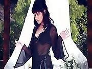 Black Haired Milf Rivi Madison Poses Naked Inside A Garden