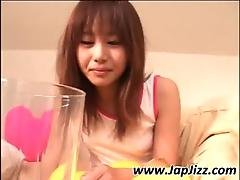 Asian Girl Drinking Pee From A Glass