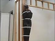 Suspended In Latex Cocoon And Gagged