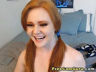 Redhead Inserts A Huge Dildo In Her Pussy