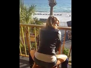 Boots And Short Skirt Dripping Wet Pussyrides Dildo Hotel Deck.