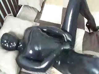 Girl-in-latex-catsuit-masturbates