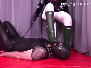Slave Cleaning My Rubber Boots With His Tongue.