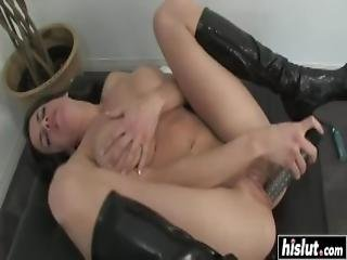 Brunette In Boots Plays With A Dildo