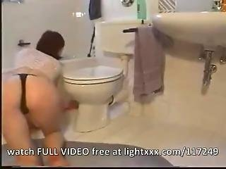 Redhead Rubbing In The Toilet