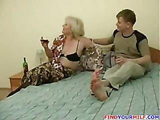 Perky Mom Seduced By Young Dude