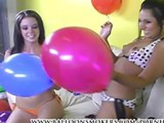 Two Lesiban Teens Smoke Cigarettes And Pop Balloons