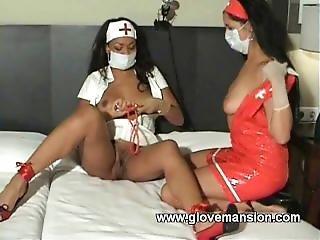 2 Nurses With Masks.