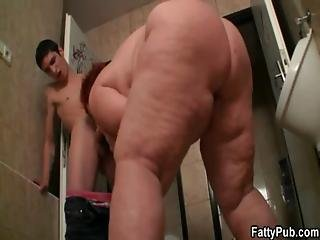 Enormous Woman Takes It In The Public Restroom