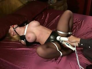 Blonde In Latex Bondage