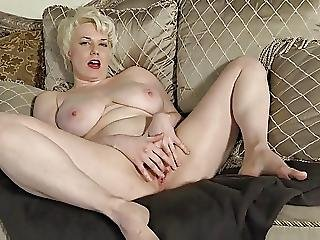 Busty Milf Fingering On The Couch