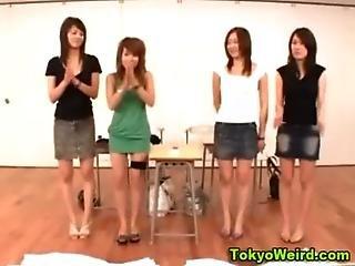 Asian teen girls strip in the classroom