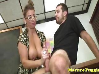 Mature Tugging Teacher Makes Student Cum