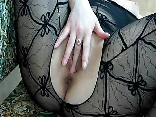 A Girl In A Sexy Suit Masturbates Her Pussy With Her Fingers.