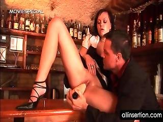 Waitress Gets Snatch Fucked With Big Dildo On The Bar