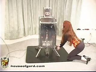 Catsuit Doll Kendra Machine Fucked In Clear Box