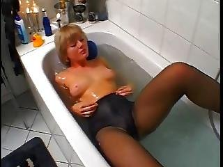 Cute Blonde Using Glass Dildo And Putting On Black Pantyhose