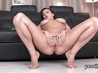 Striking Kitten Is Peeing And Pleasing Shaved Vagina