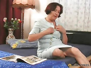 Lonely Aunt Squeezes Her Breasts