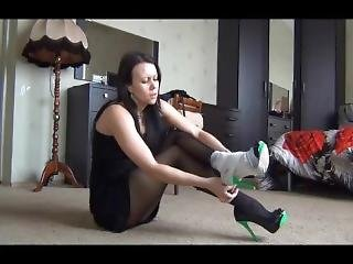 Girl Desperately Bandaging Over High Heel After A Terrible Sprain