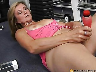 Lonely Blonde Playing With Toy