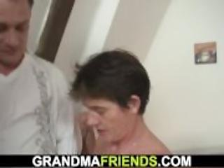 Old woman in red lingerie swallows two dicks