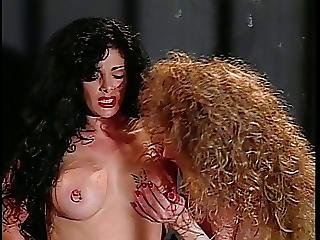 Longhaired Brunette Gets Doggystyle From Curly Haired Tranny