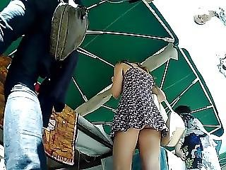 Chick Upskirted At Market Stall Sexy