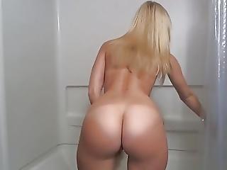 Blonde With A Hot Ass And Shaved Pussy Dildoes In The Shower
