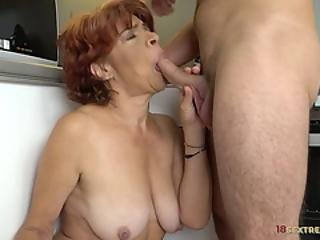 Redhead Granny Riding A Hard Wang