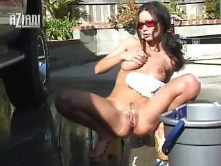 Sexy Naked Babe Washes Her Truck Naked