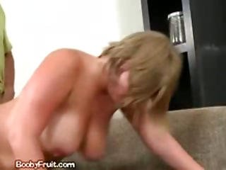 Blond Rides Cowgirl While Smothering Man With Juggs
