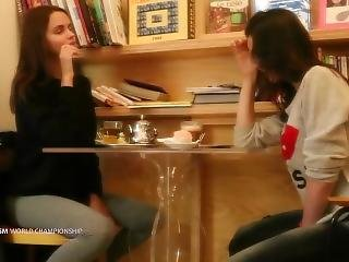 Two Girls Two Remote-controlled Toys And A Table In A Crowded Caf�