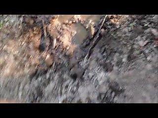 Woman Walks In Mud In Her Puma Socks.