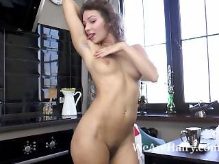 Simona Strips And Masturbates In Kitchen