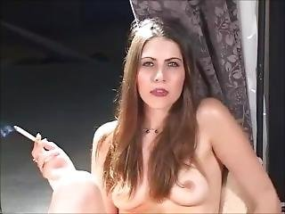 Attractive Babe Touching Her Sexy Body And Smoking For Her Date