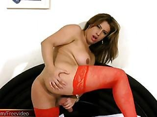 Chubby Shebabe In Red Stocking Plays With Shecock On The Bed