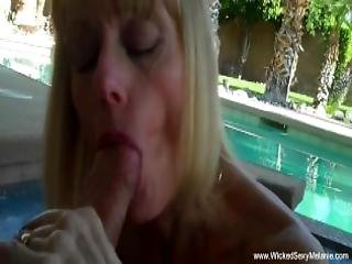 Blowjob In The Backyard Pool From Mommy