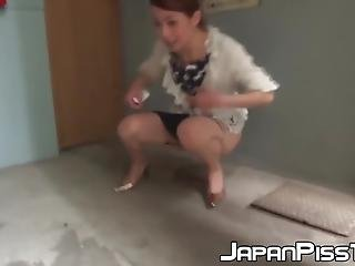 Distressed Japanese Lady Urinating In High Heels