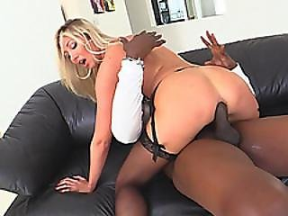 Busty Blonde Babe Enjoys Riding Big Black Rod