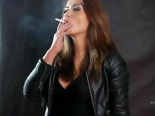 Brunette Smoking In Leather And Boots
