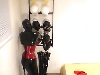 Catsuit Fetish Girl In Latex Corset