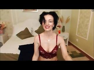 Sexy Milf Flexes Her Biceps And Does Hairplay