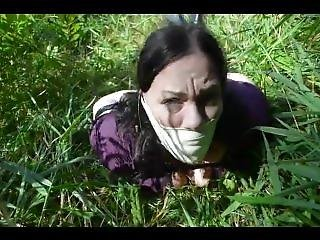 Massively Gagged Girl Struggles Outdoors