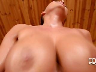 Busty Brunette Fucks In A Sauna