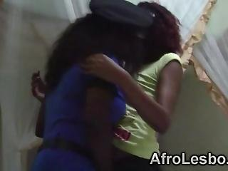 African Lesbians Decided To Take Care Of One Anothers Shaved Cunts They Enjoy Putting Their Tongues To A Good Use By Licking Pussies In A Bedroom