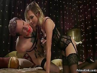 Blonde Dominatrix Puts Chastity To Sub