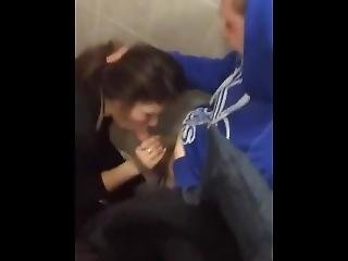 Cute Young Brunette Gets Caught Giving Head In A Public Bathroom